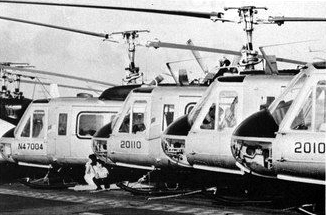 Air_America_Bell_205s_on_USS_Hancock_CVA-19_in_1975