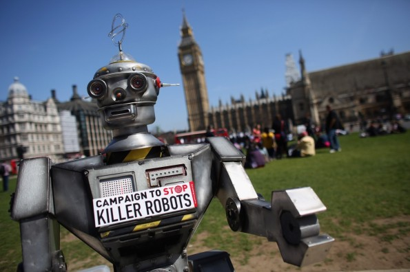A robot distributes promotional literature calling for a ban on fully autonomous weapons, in London in 2013.